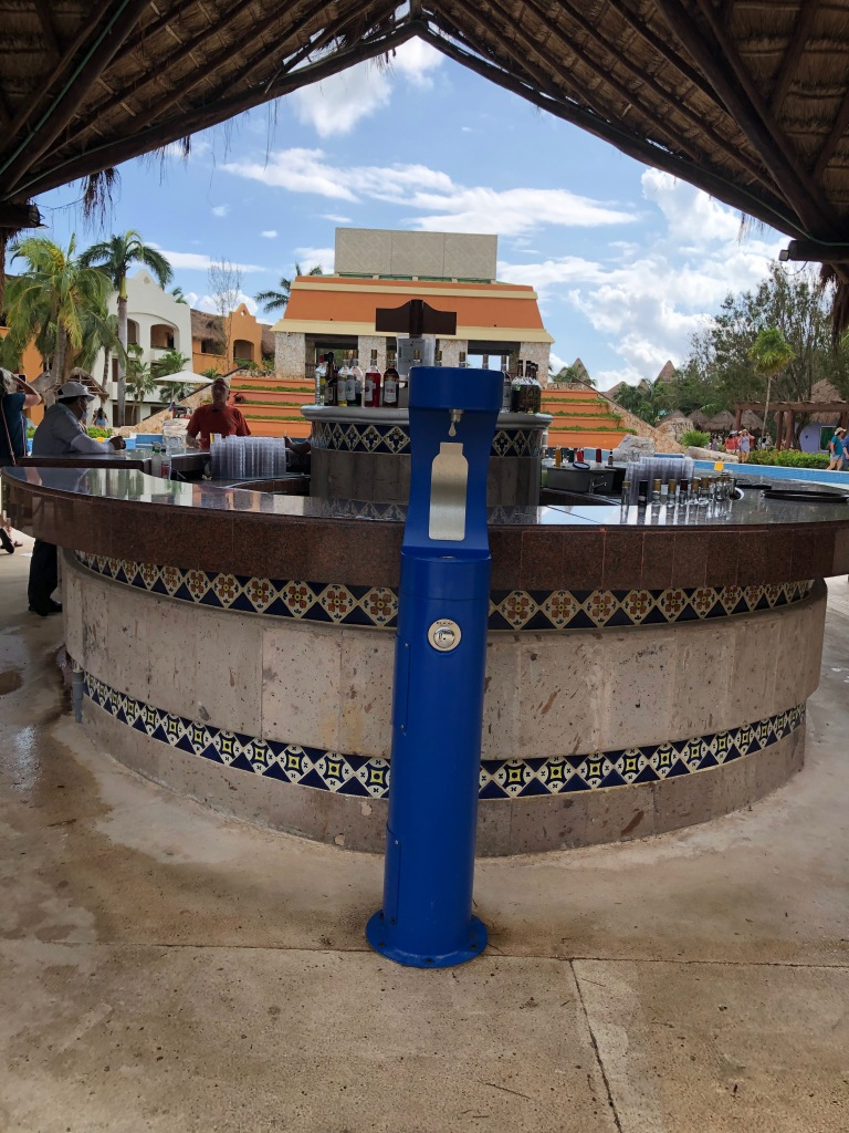Water stations are located throughout for filling reusable glass bottles.